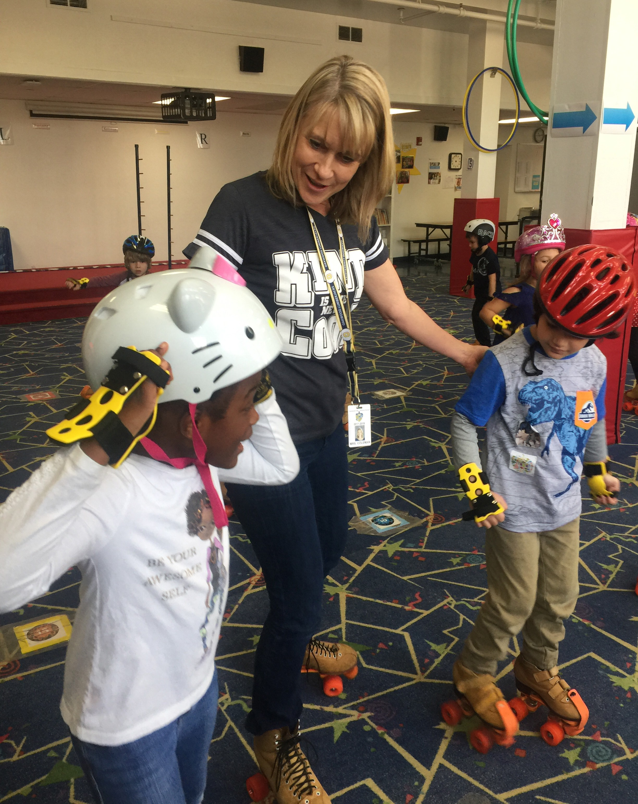Kindergarten students roller skate in P.E. class
