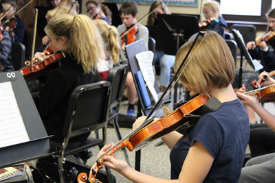 Students practicing in orchestra